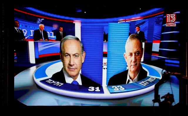 Zaradi tesnih in neodločenih izidov pa možnost tretjih volitev ni povsem izključena. Predsednik Rivlin je sicer zagotovil, da bo naredil vse, da bi jih preprečil. FOTO: Amir Cohen/Reuters