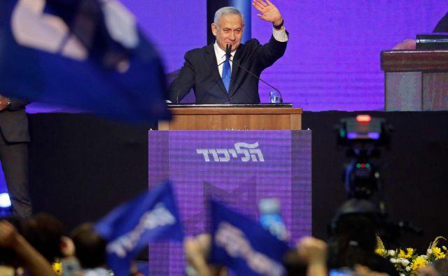 Koalicijski pogovori so se že začeli, je po zaprtju volišč komentiral dosedanji premier Netanjahu. FOTO: Jack Guez/AFP