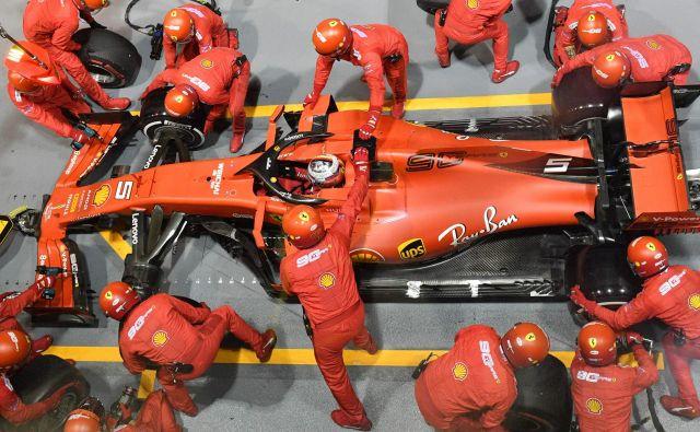 Sebastian Vettel je po sušnih 392 dneh spet slavil zmago. FOTO: AFP