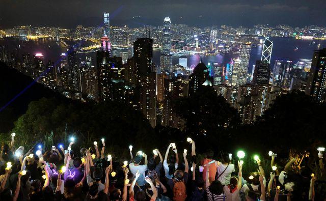 Od leta 2008 je Hongkong pri merjenju državljanskih svoboščin padel s 17. na 32. mesto med 162 državami in ozemlji, Kitajska pa z 129. na 141. mesto. FOTO: Tyrone Siu/Reuters