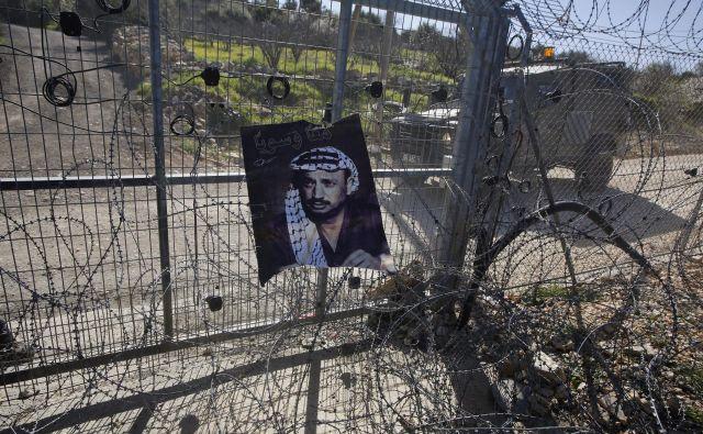 Če vas vprašajo, od kod ste, recite, da iz dežele, katere zgodovina je Jaser Arafat!<em> </em>FOTO: Mussa Qawasma/Reuters