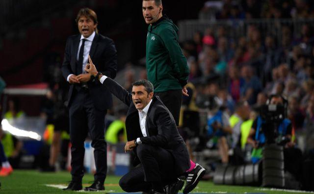 Ernesto Valverde (v ospredju) je v prvem polčasu dobil tudi taktično lekcijo Antonia Conteja, v drugem pa je bil on tisti, ki je Italijanu pripravil lekcijo. FOTO: AFP
