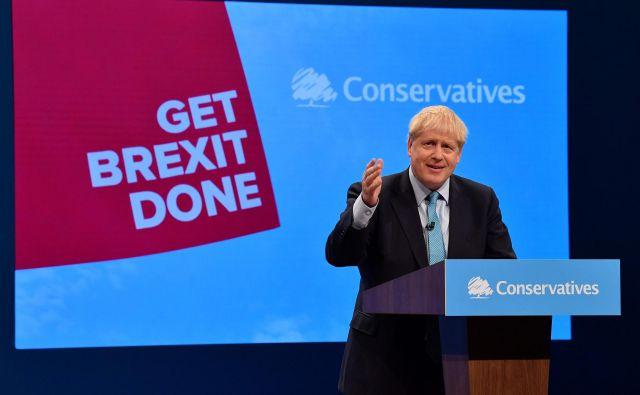 Britanski premier Boris Johnson med nastopom na kongresu konservativne stranke v Manchestru. FotoAfp