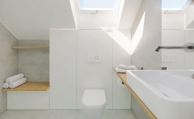 Majhna kopalnica v mansardi. FOTO: arhitekti ekipe Celovito