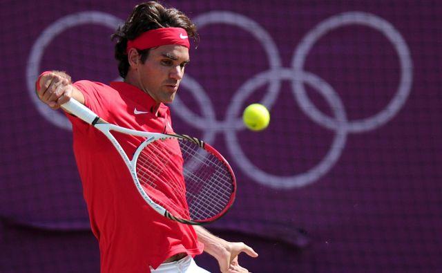 Roger Federer je na OI osvojil zlato kolajno v dvojicah s Stanom Wawrinko in srebrno med posamezniki. FOTO: AFP