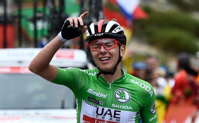 Nepozabni trenutek iz letošnje sezone: zmaga Tadeja Pogačarja v 20. etapi Vuelte, s katero si je zagotovil končno 3. mesto. FOTO: AFP