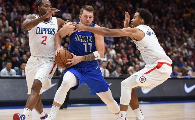 Z Luko Dončićem je imel polne roke dela tudi MVP zadnjega finala lige NBA Kawhi Leonard (levo), ki se je iz Toronta preselil k LA Clippers. FOTO: USA Today Sports