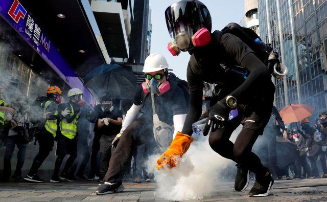 Tisto, kar bolj kot vse povezuje Katalonce in Hongkonžane, je zahteva po ponovni opredelitvi njihove identitete. FOTO:Tyrone Siu/Reuters
