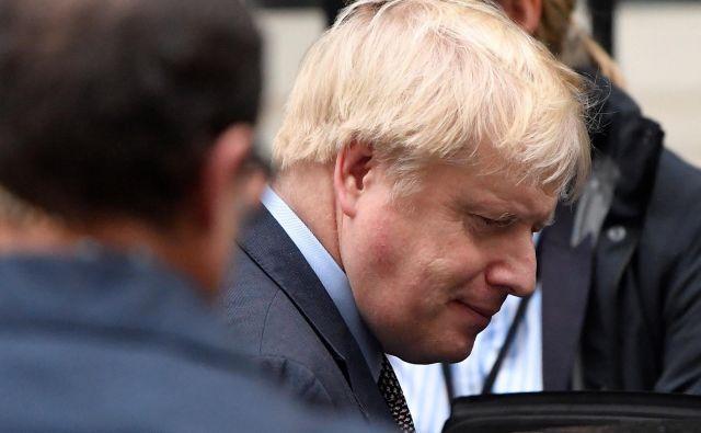 Boris Johnson bo skušal poslance prepričati, naj bodo 12. decembra volitve. FOTO: Toby Melville Reuters