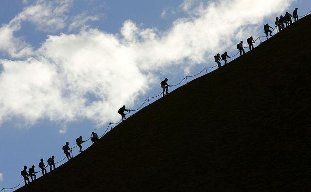 Tovrstne fotografije bodo od sobote naprej le še v spominskih albumih. FOTO: Torsten Blackwood/AFP