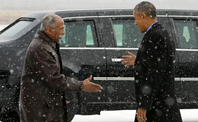 John Conyers leta 2016 ob srečanju z Barackom Obamo. FOTO: Jonathan Ernst/Reuters
