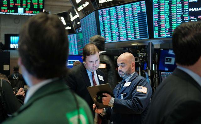 Analitiki pričakujejo, da bo proti koncu leta razpoloženje na borznih trgih pozitivno. FOTO: AFP