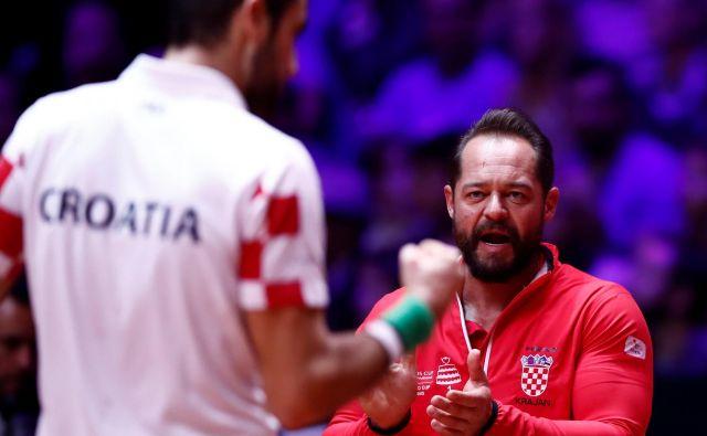 Težave so se pri Hrvatih začele, ko je Marin Čilić (levo) zaradi poškodbe odpovedal nastop na finalnem turnirju za Davisov pokal v Madridu. Selektor Željko Krajan (desno), ki je lani osvojil lovoriko z izbrano vrsto, dva dni pred odhodom v Španijo ni več selektor. FOTO: Reuters