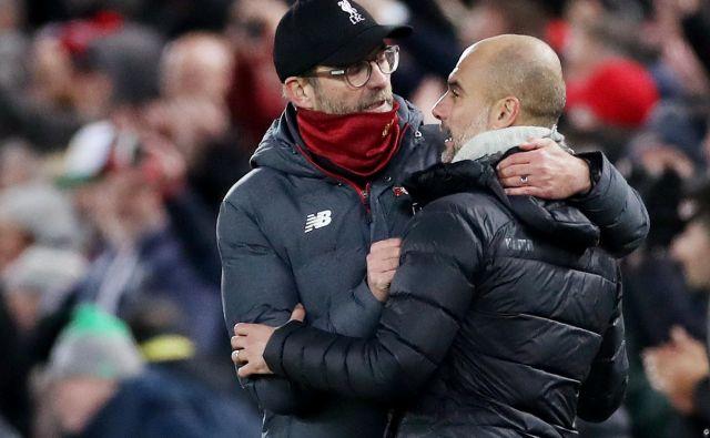 Trener Cityja Pep Guardiola (desno, takole je čestital Jürgnu Kloppu) na nobenem štadionu ni izgubil večkrat kot na Anfieldu (4). FOTO: Reuters