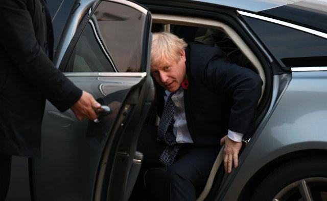 Britanski premier Boris Johnson je še pred mesecem dni objubljal, da njegova vlada ne bo nominirala kandidatov za britanskega člana nove evropske komisije. FOTO: Reuters