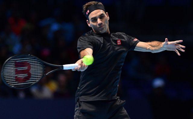 Rogerja Federerja čaka najtežje delo na koncu skupinskega dela tekmovanja – jutri se bo pomeril z Novakom Đokovićem. FOTO: AFP