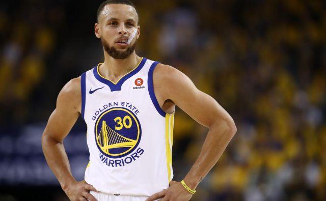 Stephen Curry naj bi se na igrišča spet vrnil šele enkrat spomladi. FOTO: AFP