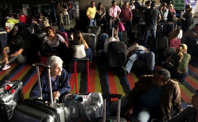 Doslej je urad prejel 17 prošenj za repatriacijo 52 ljudi slovenskega porekla in njihovih družinskih članov. FOTO: Marco Bello/Reuters