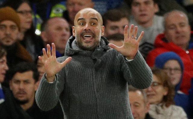 Po porazu v Liverpoolu se je Pep Guardiola spomnil na skupino navijačev, ki so septembra potovali v Harkiv in popirali Manchester City v prvi tekmi lige prvakov v tej sezoni. FOTO: Reuters
