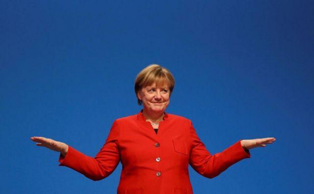 Angela Merkel si lahko oddahne, ni pa čas za odpiranje šampanjcev. FOTO: Reuters<br />