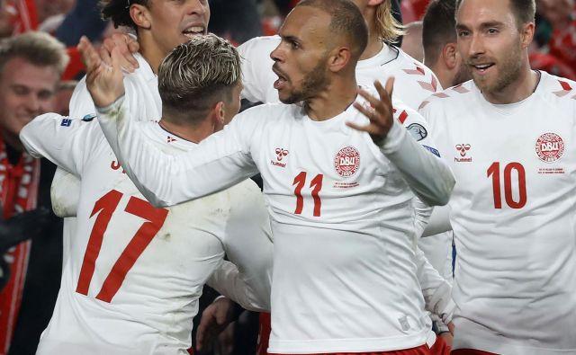 Danski nogometaši so se takole veselili uvrstitve na evropsko prvenstvo. FOTO: AFP