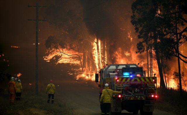 Dim se je dvignil tudi nad Sydney. FOTO: Stringer Reuters
