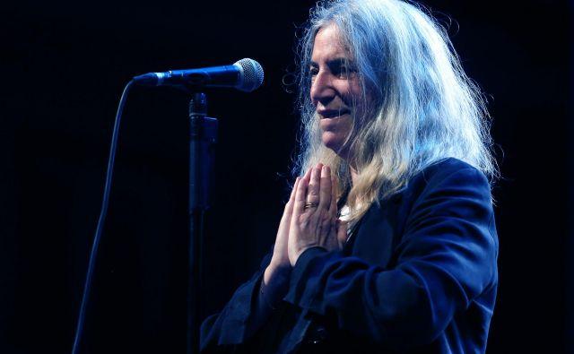 Legendarna Patti Smith, kot so jo ujeli Delovi fotografi med koncertom v Križankah v Ljubljani. FOTO: Aleš Černivec/Delo