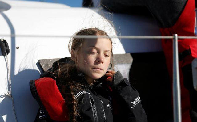 Po 20 dneh plovbe je Greta Thunberg prišla do Lizbone. FOTO: Rafael Marchante/Reuters