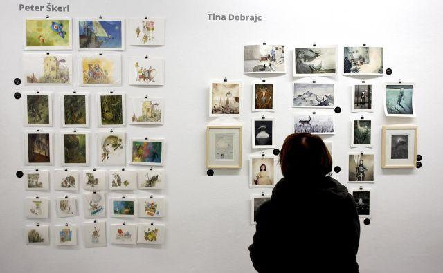 Na 84 kvadratnih metrih galerije razstavljajo dela 28 ilustratork in ilustratorjev. FOTO: Roman Šipić/Delo