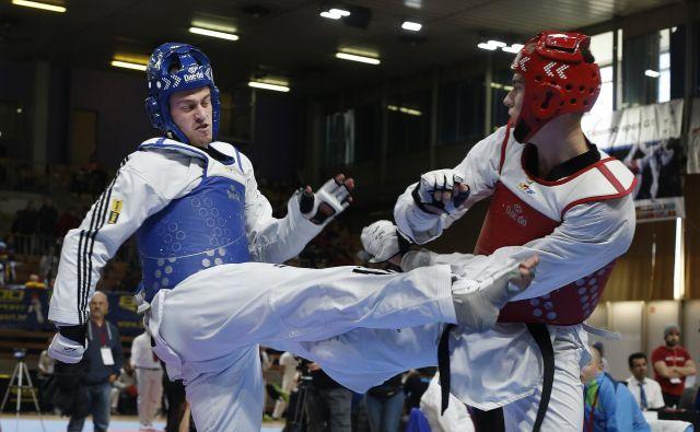 Ivan Trajković (levo) sodi med najboljše tekvondoiste na svetu v kategoriji nad 80 kilogramov. FOTO: Blaž� Samec