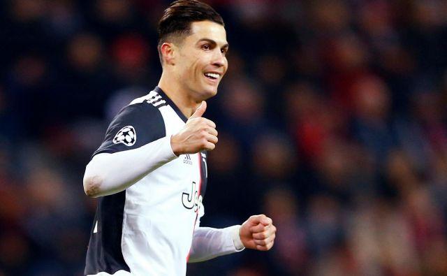 Cristiano Ronaldo je zabil v Leverkusnu že svoj 128. gol v ligi prvakov. FOTO: Reuters