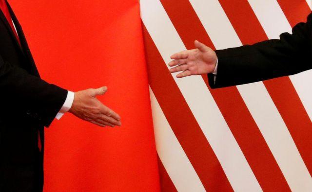 Amneriški predsednik Donald Trump in kitajski Ši Džinpeng novembra 2017 v Pekingu.Foto Damir Sagolj Reuters