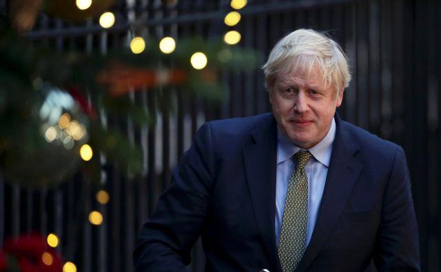 Johnsonovi konservativci so na četrtkovih predčasnih volitvah osvojili absolutno večino v britanski poslanski zbornici. FOTO: Lisi Niesner/Reuters