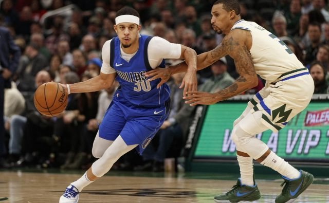 Seth Curry (z žogo) je bil med najzaslužnejšimi za zmago Dallasa. FOTO: Usa Today Sports