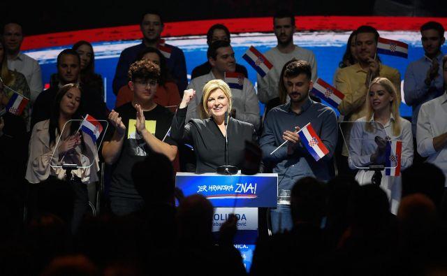 Kolinda Grabar Kitarović je prva hrvaška predsednica. Ali ji bo uspelo ponoviti mandat, bo bržkone jasno 5. januarja. FOTO: Goran Mehkek/Cropix