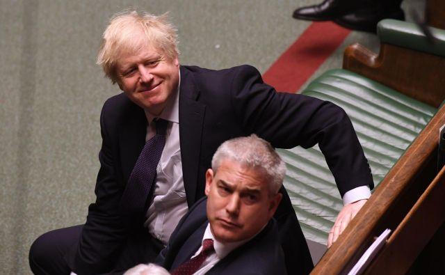 Vlada Borisa Johnsona je v parlamentarno proceduro vložila predlog zakona o uveljavitvi ločitvenega sporazuma z EU. Foto: Jessica Taylor/Afp
