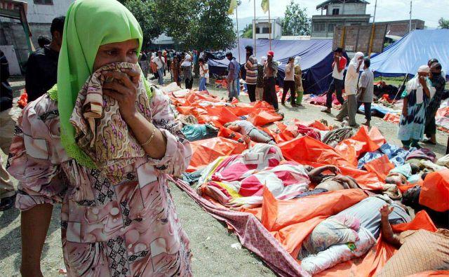 Najhuje je prizadel sever indonezijske pokrajine Aceh, kjer je umrlo 128.858 ljudi, več kot pol milijona prebivalcev je ostalo brez strehe nad glavo. Foto Reuters