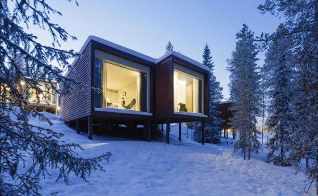 Hiške, ki so jih zasnovali v arhitekturnem biroju Studio Puisto, se zlivajo s finsko pokrajino. Foto Marc Goodwin