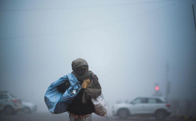 Danes vremenoslovci v indijski prestolnici pričakujejo najbolj mrzel dan v 119 letih.FOTO: Jewel Samad/Afp