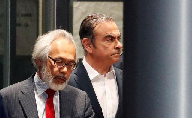 Carlos Ghosn (desno) je bil priprt na Japonskem, od koder je pobegnil pred sojenjem. FOTO: Reuters