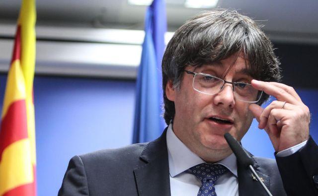 »Belgijsko sodišče priznava najino imuniteto in je opustilo nalog za aretacijo in izročitev,« je ob tem na Twitterju zapisal Puigdemont. FOTO: Aris Oikonomou/AFP