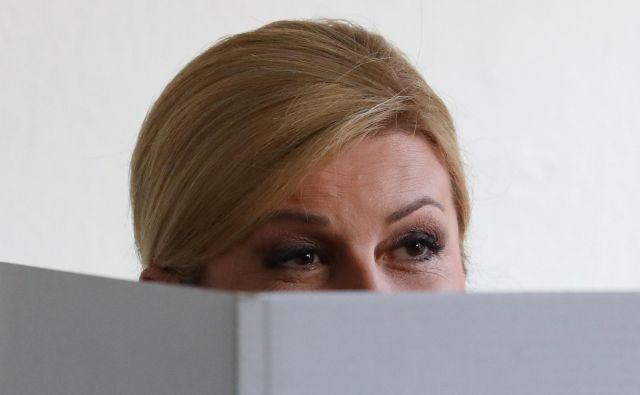 Kolinda Grabar-Kitarovič včeraj na volišču. FOTO: Marko Djurica/Reuters