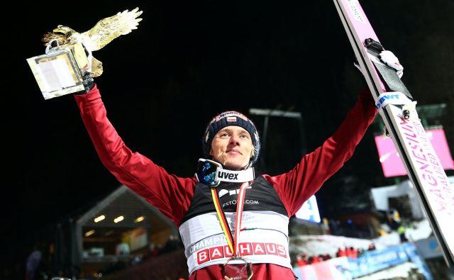 Dawid Kubacki je postal tretji Poljak s prestižno lovoriko zlatega orla. FOTO: Reuters