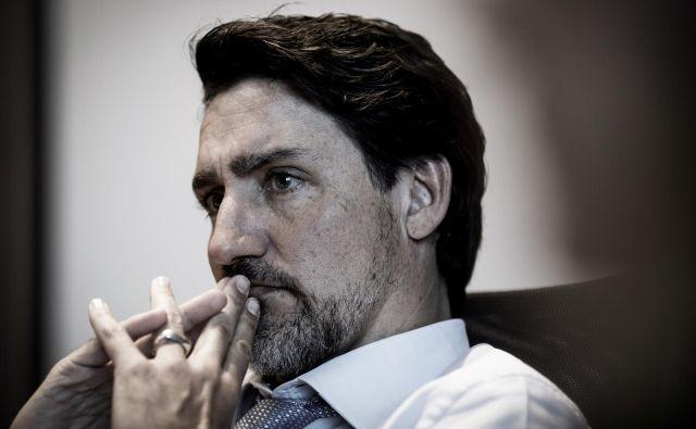 Justin Trudeau, kanadski premier, ponavadi obrit do gladkega, je po praznikih dvignil prah z brčicami in brado. FOTO: Adam Scotti via Reuters