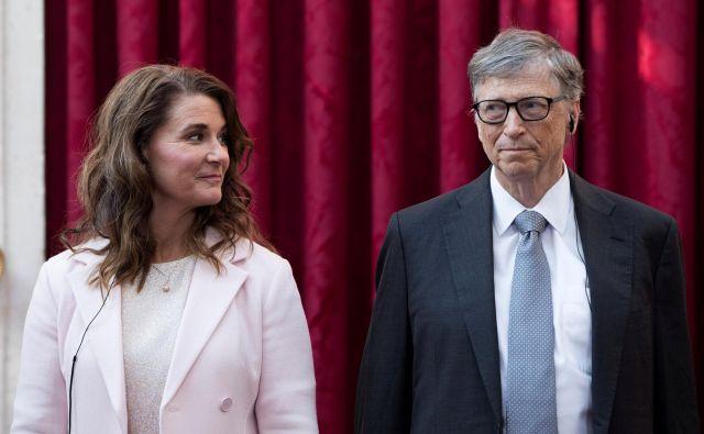 Ustanovitelj Microsofta Bill Gates (levo žena Melinda) je plačal več davkov kot kdorkoli, ampak jih hoče plačati še več. Foto Reuters