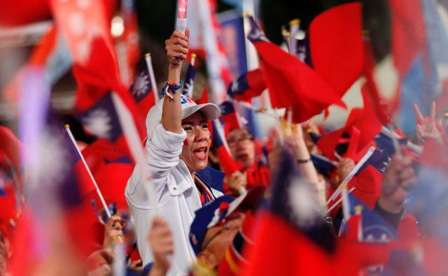 Približno 19,5 milijona tajvanskih volivcev bo danes izbiralo predsednika in člane parlamenta. FOTO: Reuters