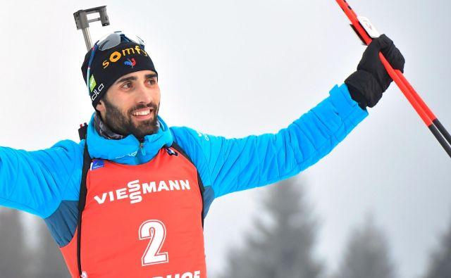 Martin Fourcade je z zmago prevzel tudi vodstvo v skupnem seštevku svetovnega pokala. FOTO: Tobias Schwarz/AFP