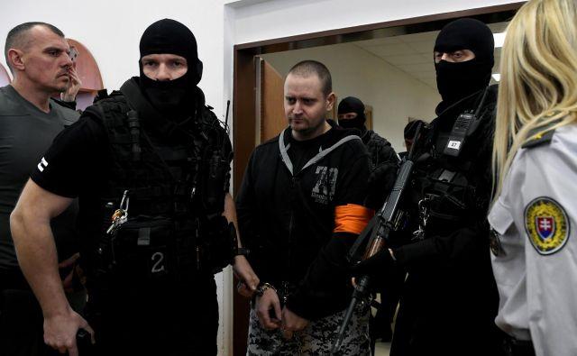 Štirim obtoženim grozi 25 let zapora, če jih bodo spoznali za krive. FOTO: Radovan Stoklasa/Reuters