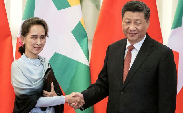 Kitajski predsednik se bo v Burmi srečal z Aung San Su Či, ki je uradno državna svetovalka, dejansko pa na čelu države. FOTO: Reuters