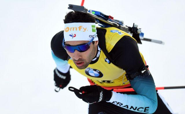 Francoski biatlonec Martin Fourcade je v tej sezoni zmagal že tretjič zapored. FOTO: AFP
